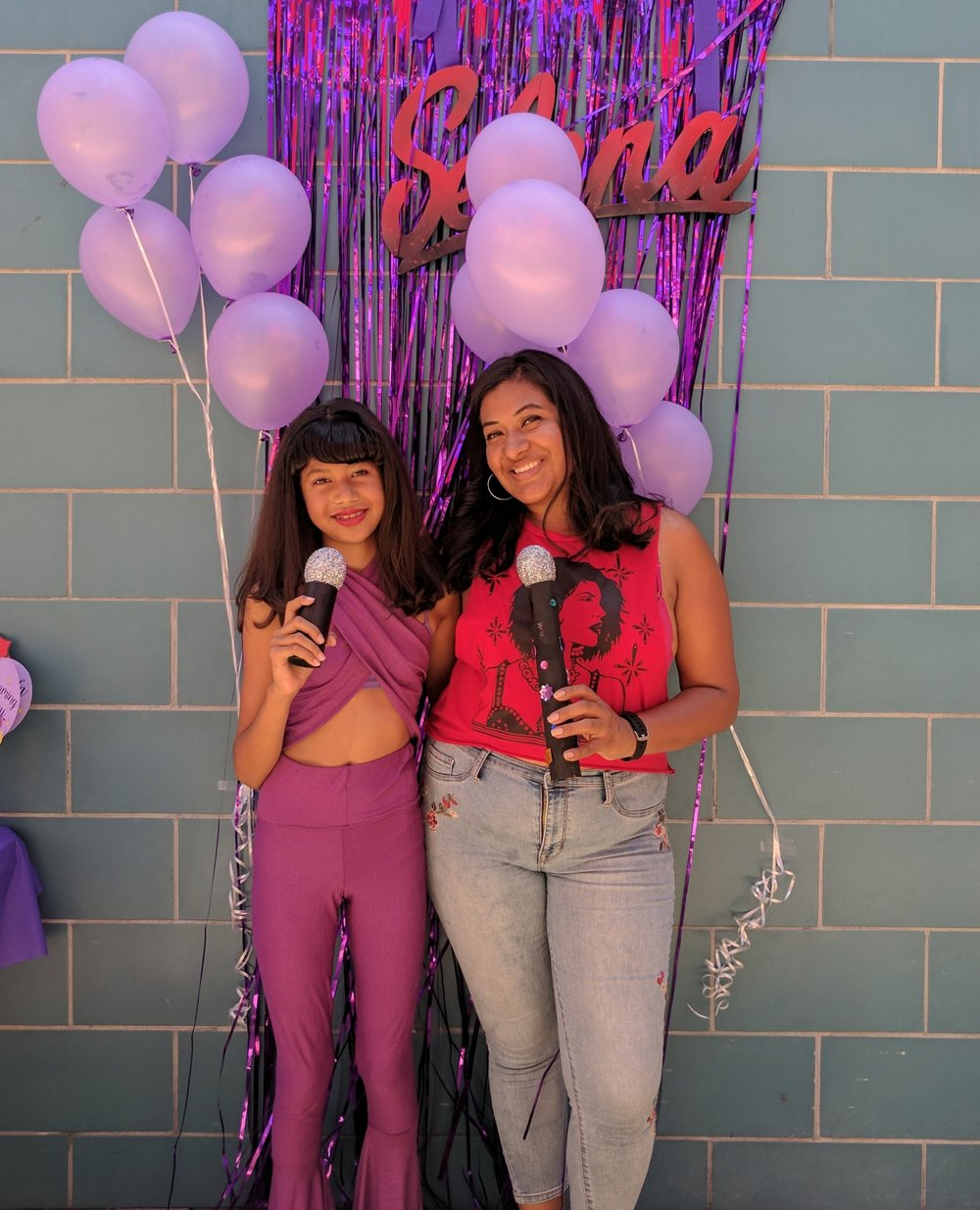 "10-year old Lucia with her mom Amorette posing to make new ""Fotos y Recuerdos"" ( Pictures & Memories , a popular song from Selena's hit album  Amor Prohibido )."
