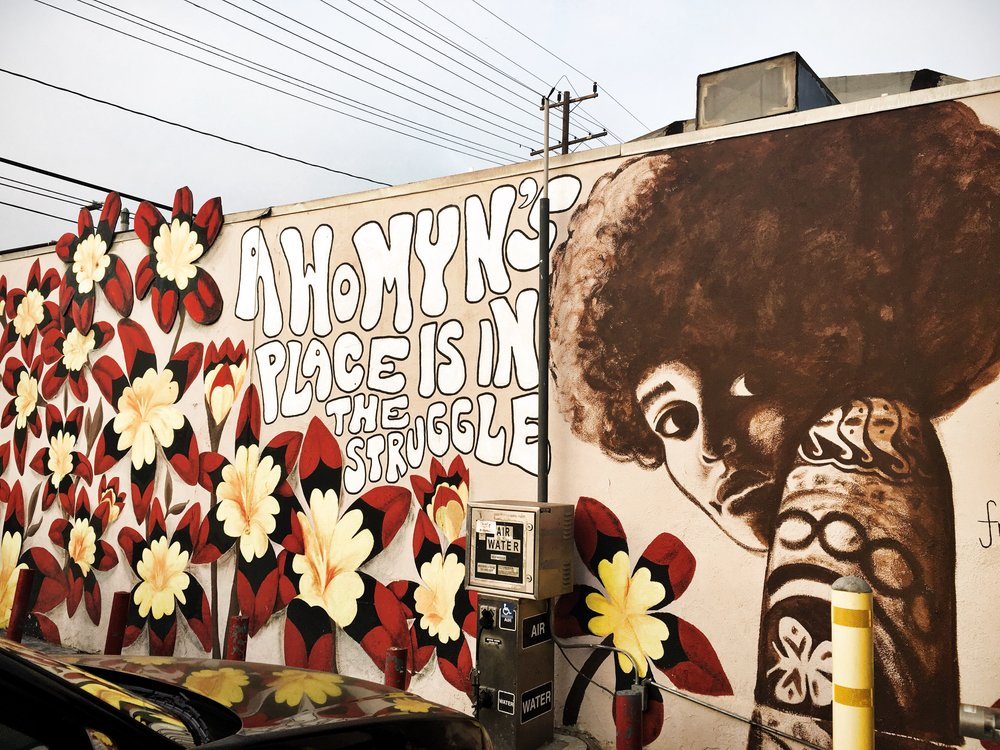 Mural of Assata Shakur by Kristy Sandoval at StylesVille Beauty & Barber Shop in Pacoima, CA.