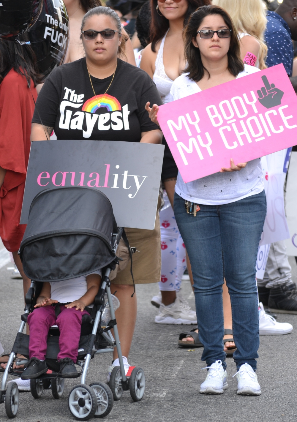 Abigail Gil and Shantrece Williams join the crowds at the 3rd Annual Amber Rose SlutWalk with their 2-year old daughter.