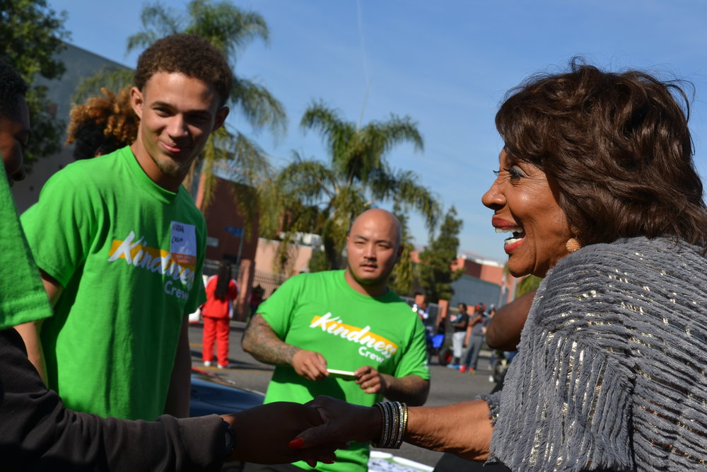 Congresswoman Waters is introduced to area volunteers.