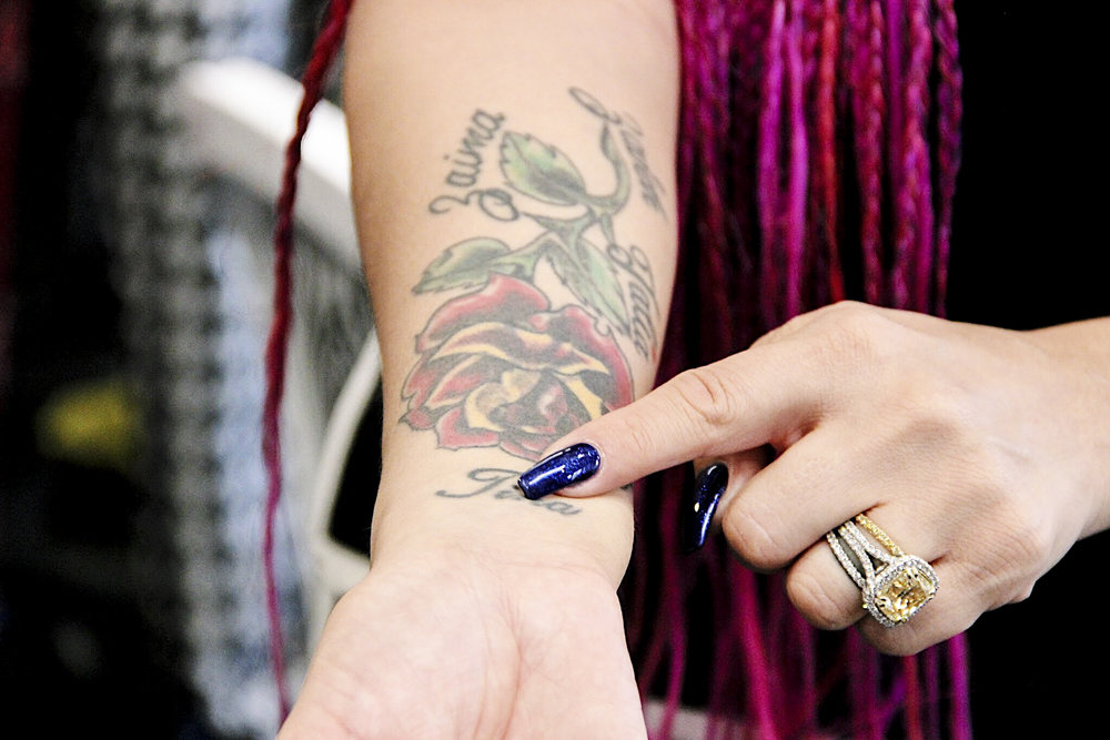Urbana has her kids' names tattooed, including the name of a young girl named  Talia Castellanos  who Chappa helped launch a mini fashion line before the young girl passed away due to cancer.