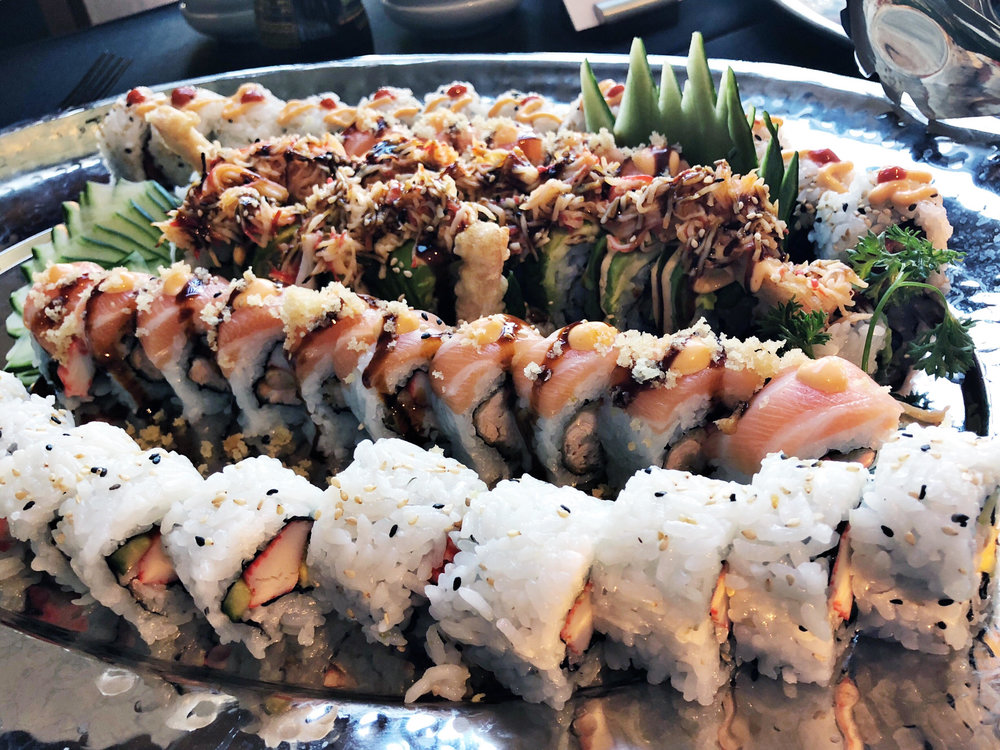 Splitzville offers a wide selection of menu items, including sushi.