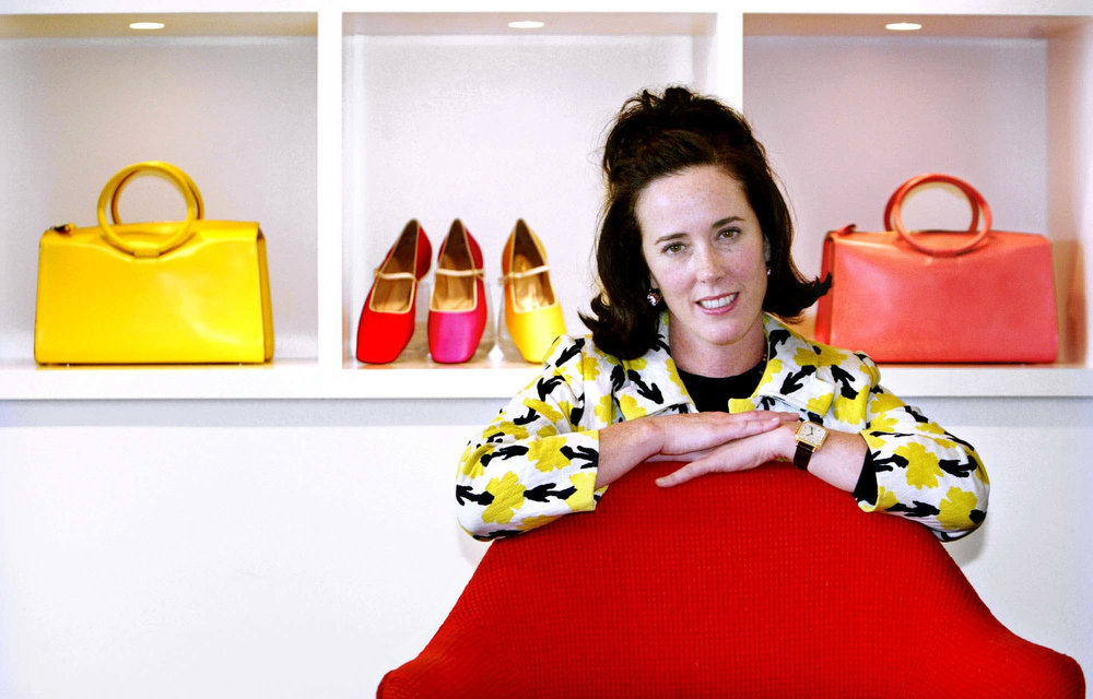 In this May 13, 2004 file photo, designer Kate Spade poses with handbags and shoes from her next collection in New York. Law enforcement officials say Tuesday, June 5, 2018, that New York fashion designer Kate Spade has been found dead in her apartment in an apparent suicide. (AP Photo/Bebeto Matthews, File)
