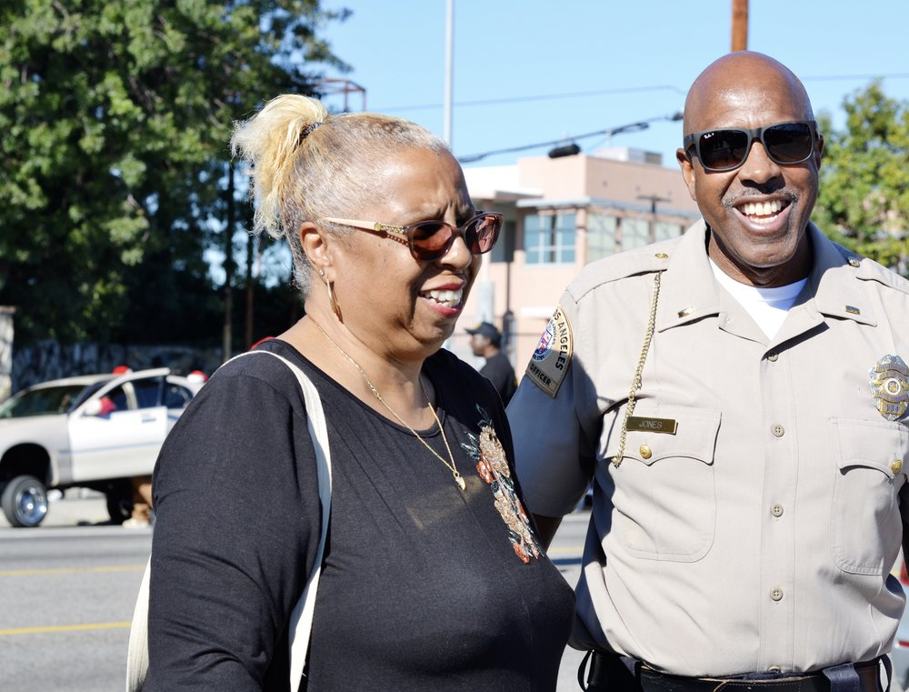 """Watts Christmas Parade Organizer, Paula Aliewine discusses last-minute parade details with law enforcement officials. On parade day, """"everybody's happy"""","""" says Aliewine."""