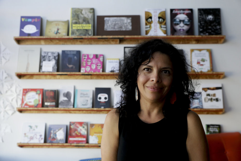In this Saturday, Nov. 3, 2018, photo, Celene Navarette poses for a  picture at La Libreria book store in Los Angeles. The market for Spanish  books is growing but the traditional publishing industry has addressed  demand in fits and starts. Three small companies have stepped in to fill  the void, launched by three different pairs of Hispanic mothers  frustrated by the dearth of Spanish-language books to reach to their  children. They swiftly found demand from major retailers like Target and  schools across the U.S. (AP Photo/Chris Carlson)