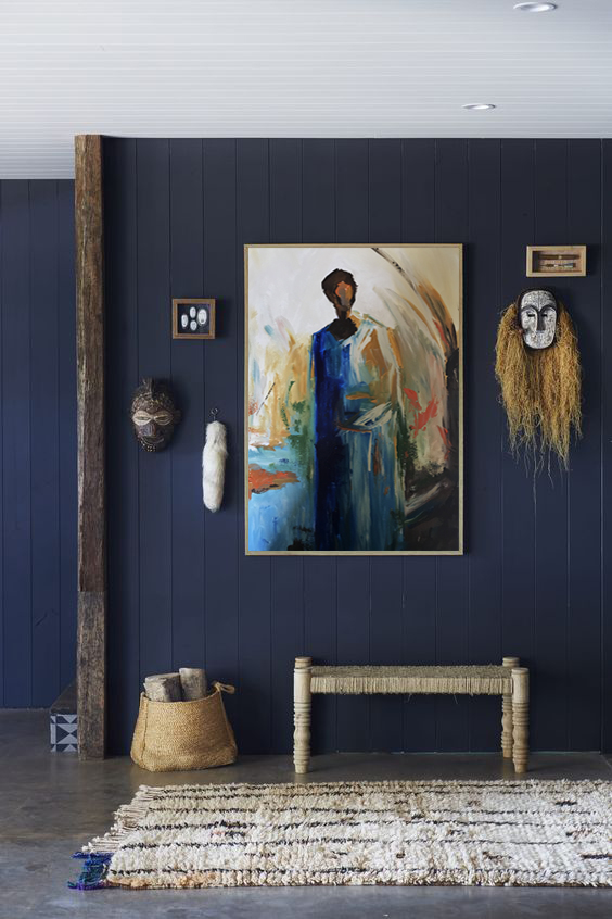 """""""By using the right colors behind the artworks, you can make the viewer walk into a room and experience a painting in a more atmospheric way.""""- Elle Decor"""