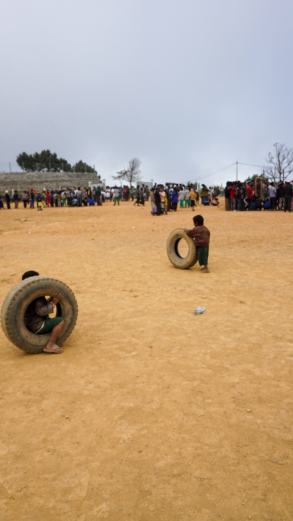 Tyre races at a local sports day to celebrate Independence Day in Mindat.