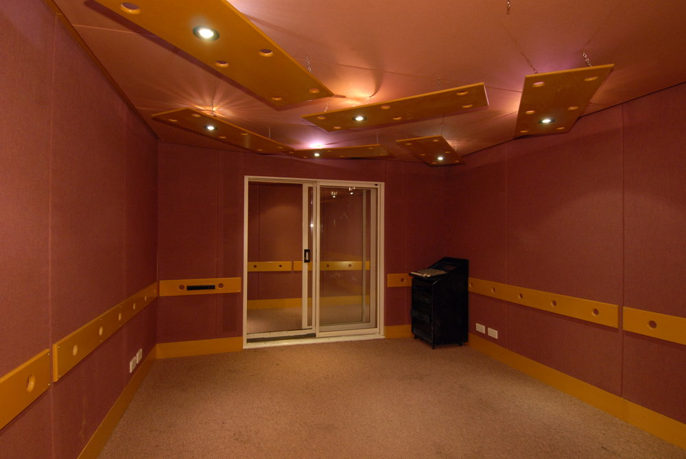 Studio 3 - Designed and built by KFA, production Suite 3 is an ideal mixing, programming, recording, production and rehearsal space. Includes an adjoining booth large enough for a drum kit. It is air conditioned (silent), sound proofed, tuned to 100hz, has quadruple glazing and is independently alarmed. This room is suitable for smaller band rehearsals.Measurements: 3.6m wide by 4.8m long. Vocal booth: 3.6m wide by 1.8m long.