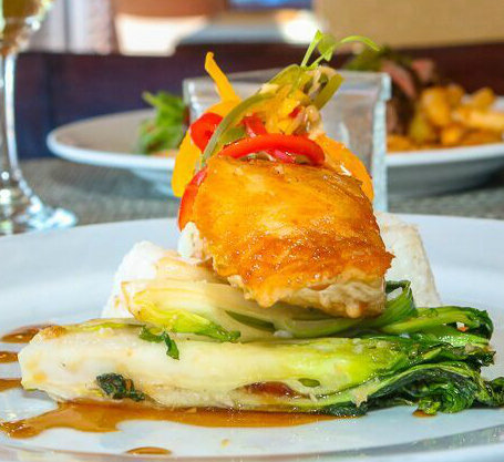 How delicious does our Chilean Sea Bass look? Soy glazed served with sticky rice, baby bok choy, ginger slaw and wasabi vinaigrette... your taste buds will definitely thank you.