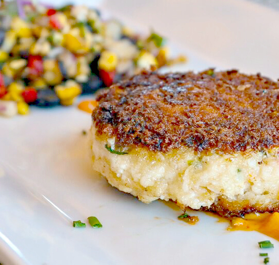 Our savory appetizers are the perfect way to start any meal. Our Lump Crab Cake is bursting with delicious flavor and served with a local corn salad and chipotle mayo.