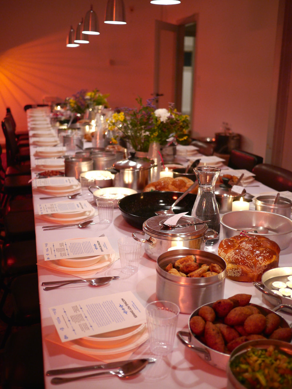 Melting Pot Dinner - A bespoke eating experience created for The White City Centre, TLV, 2016 The concept dinner took place in the former private dining room of a Jewish German immigrants' family home, now repurposed as a public research & education center. Diners were invited to gather around a large communal table and experience a typical festive Israeli family meal in a private- public space that evoked a sense of family, home & Gemütlichkeit as well as history, tradition and conviviality. The Sabbath dinner, a weekly ritual in most Israeli households, is typically composed of an excessively large array of dishes reflecting the 'Israeli cuisine'; the existing local food culture, local ingredients and the various cuisines and food memories brought by each Diaspora. The abundance of cooking pots formed a new topography; an aesthetic and gastronomic experience indicative of the various cuisines and cultures, both local and from afar, coming together to create a new identity, thus, a melting pot.Production & realisation: Arch. Sabrina CeglaDinner prepared by: Azura & Elran ShreflerGraphic design: Rachel Kinrot