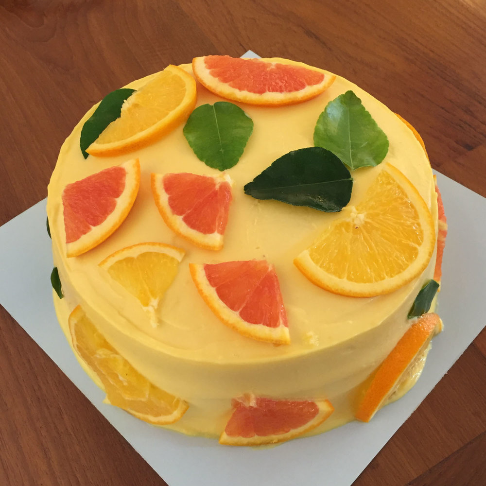 Citrus   - Soft orange zest sponge cake with vanilla bean cream. Lemon cream frosting. Medium = 2,000 THB (8-10 servings)