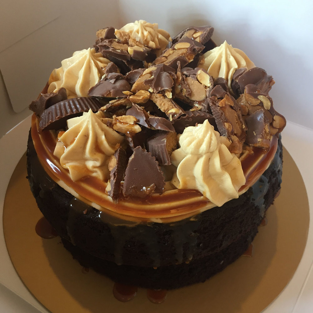 Snickers   - Half baked chocolate cake with peanut butter buttercream topped with peanut buttercups and caramel.  Baby = 1,000 THB ( 3 Servings)Medium = 1,700 THB (8-10 servings)Large = 2,500 THB (12-15 servings)