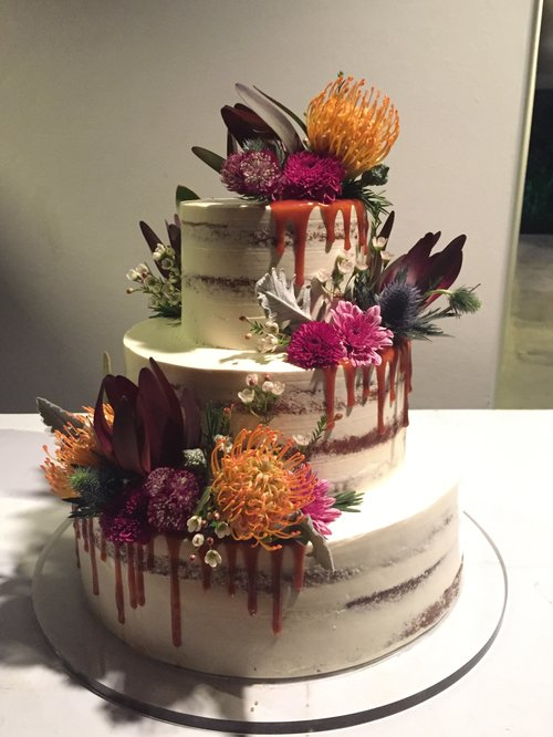 All of our wedding cakes are 100% edible, made with natural imported ingredients. No preservatives. Fresh flowers only.