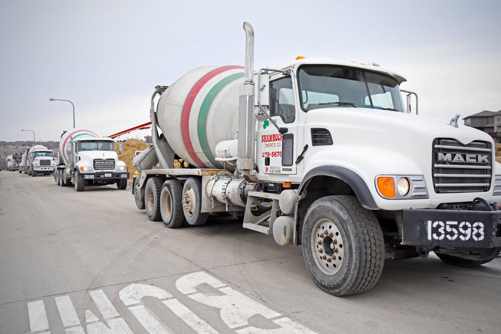 Photo by  BRADY JONES/Lyman-Richey Communications   Shamrock Concrete Co. trucks deliver concrete to a residential project in north west Omaha in early February