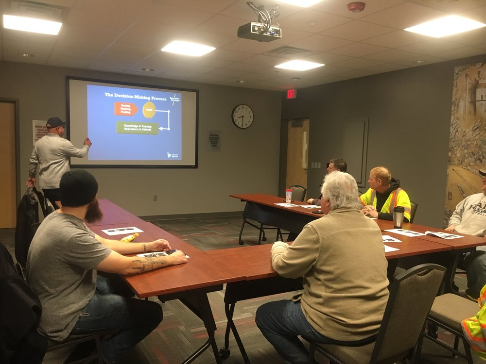 Photo courtesy of    Mark Stoffel/Gerhold Concrete Co.    Safety Administrator George Claxton goes through the classroom portion of the Decision Driving training with a class at the corporate offices in Omaha.