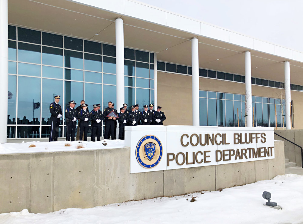Photo courtesy of CITY OF COUNCIL BLUFFS  Members of the Council Bluffs Police Department stand outside of their new headquarters for the official ribbon-cutting ceremony in January.