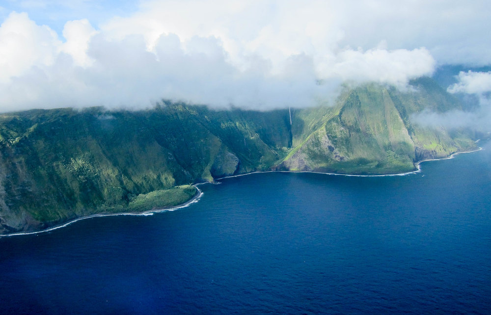 Flying by the Molokai sea cliffs which are the tallest in the world!