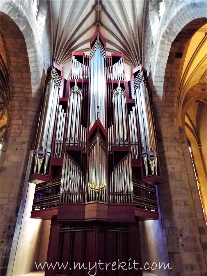 The stunning gleam of the organ's pipes.