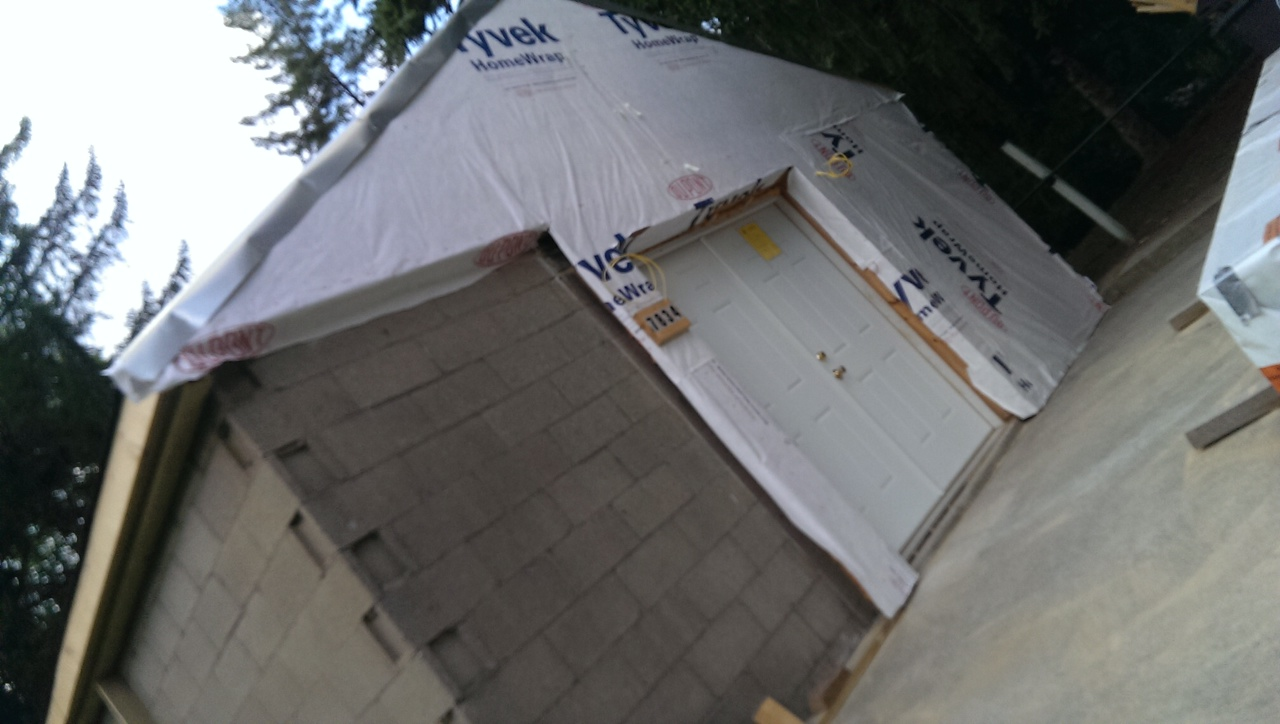 Once the insulation has been added, we cover the site over with home wrap! After inspection, it will be ready for siding.