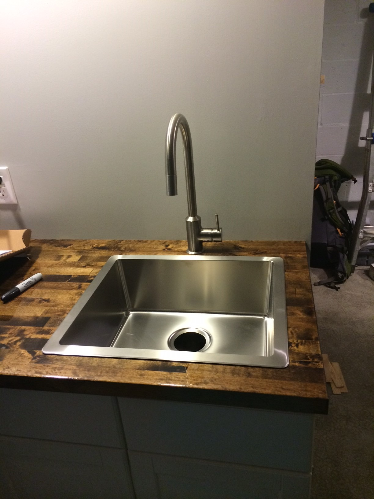 We got to work a bit more on our cabinets and got the kitchen sink placed