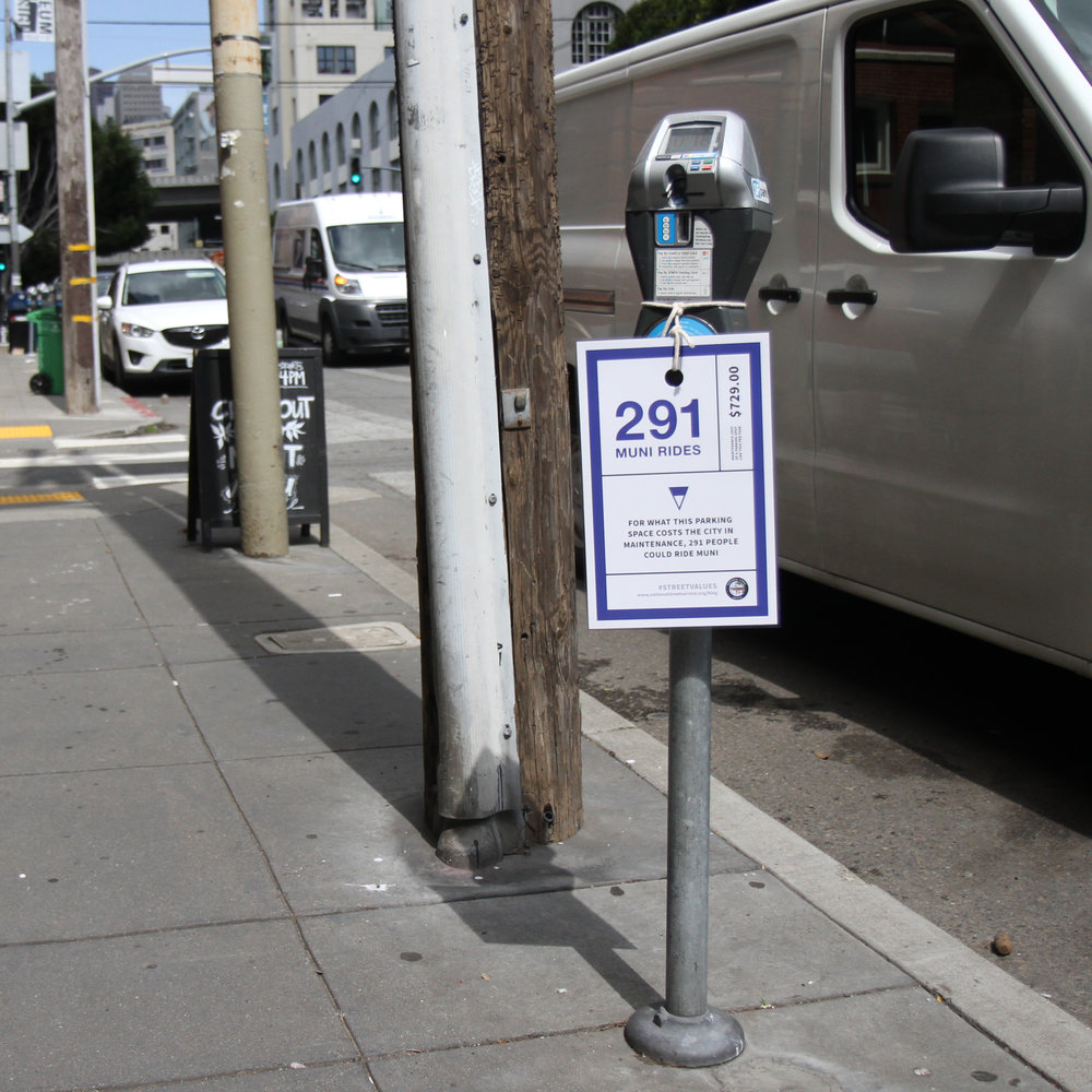 Giant Muni ticket attached to a parking meter, comparing maintenance costs to the city to the number of muni tickets which could be purchased.