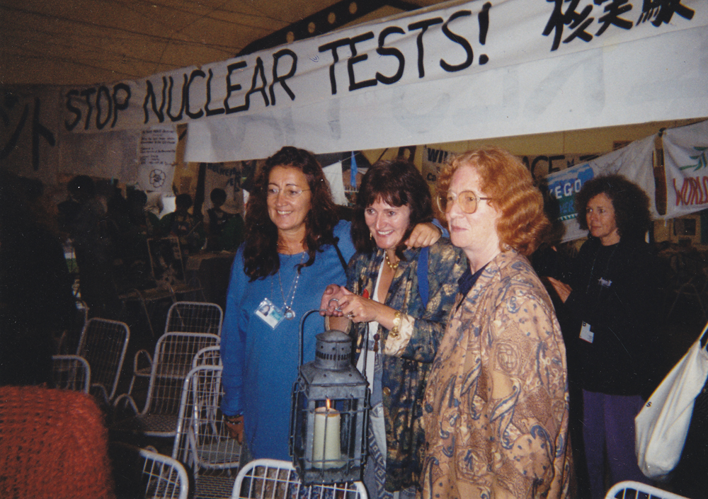 In Beijing at the UN Conference for Women, 1995, with the Sacred Flame of the Goddess, sent by the Brigidine Sisters, with the Irish singer Noirin Ni Rianin