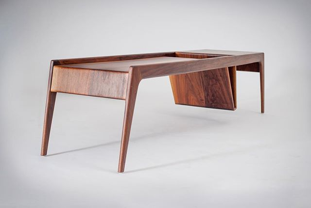 "Love from @dwellmagazine this month on ""Products We Love: The Mag Coffee Table"" . . ""They created Ali Sandifer by combining their last names. That wasn't the only thing that came together. 'At the time, Andre was influenced by the rectilinear and I was influenced by curvature,' says Ali. That blend became a signature of their work, along with their use of unstained American hardwoods."" . . ""Their Mag Coffee Table embodies all of that. Designed to solve the eternal problem of what to do with all those books and magazines, the table has a storage component in its belly. 'The challenge was, how do you achieve that without bending plywood or using different materials?' Sandifer asks."" . . #alisandifer #design #craft #modern #furniture #detroit #midwest #abirandandre #mag #walnut #hardwoods #belly #storage #madeinamerica"