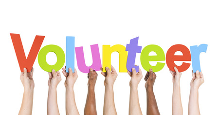 35334421_S_volunteer_hands_volunteer sign.jpg