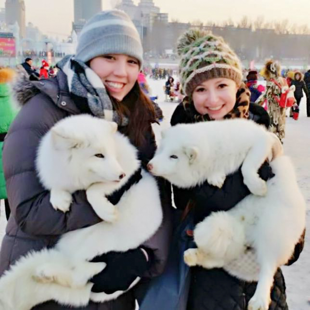 Snuggling for warmth at the frigid – but dazzling – Harbin Ice Festival.