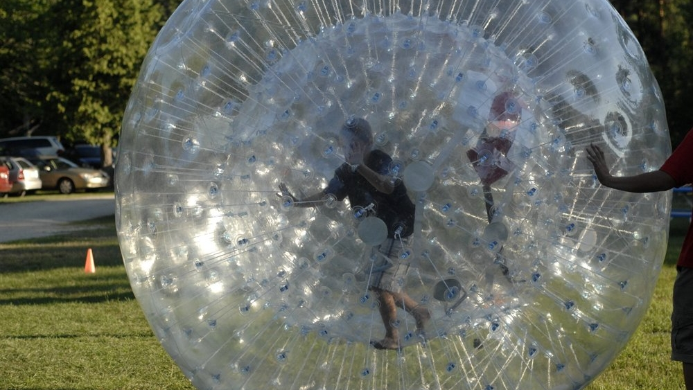Zorb Balls - 10 foot tall human hamster balls that adults can stand up in for the ultimate human hamster ball race.