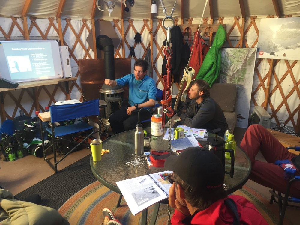 IFMGA Guide and AIARE instructor, Jonathon Spitzer brings it back to the classroom during an AIARE Level 2 hosted at Ruby Mountain Heli-Ski's yurt at 10,000'.