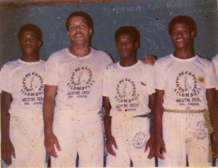 "A young Mestre Bomba, far left, with Mestre Benivaldo, second from left, as members of Mestre Dede's Grupo Quilombola, the ""grandfather"" group of Capoeira Barro Vermelho, in Salvador, Bahia Brazil."