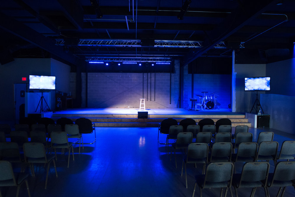 Stage and venue lighting-mounted flat screens and newley added white background wall for projection