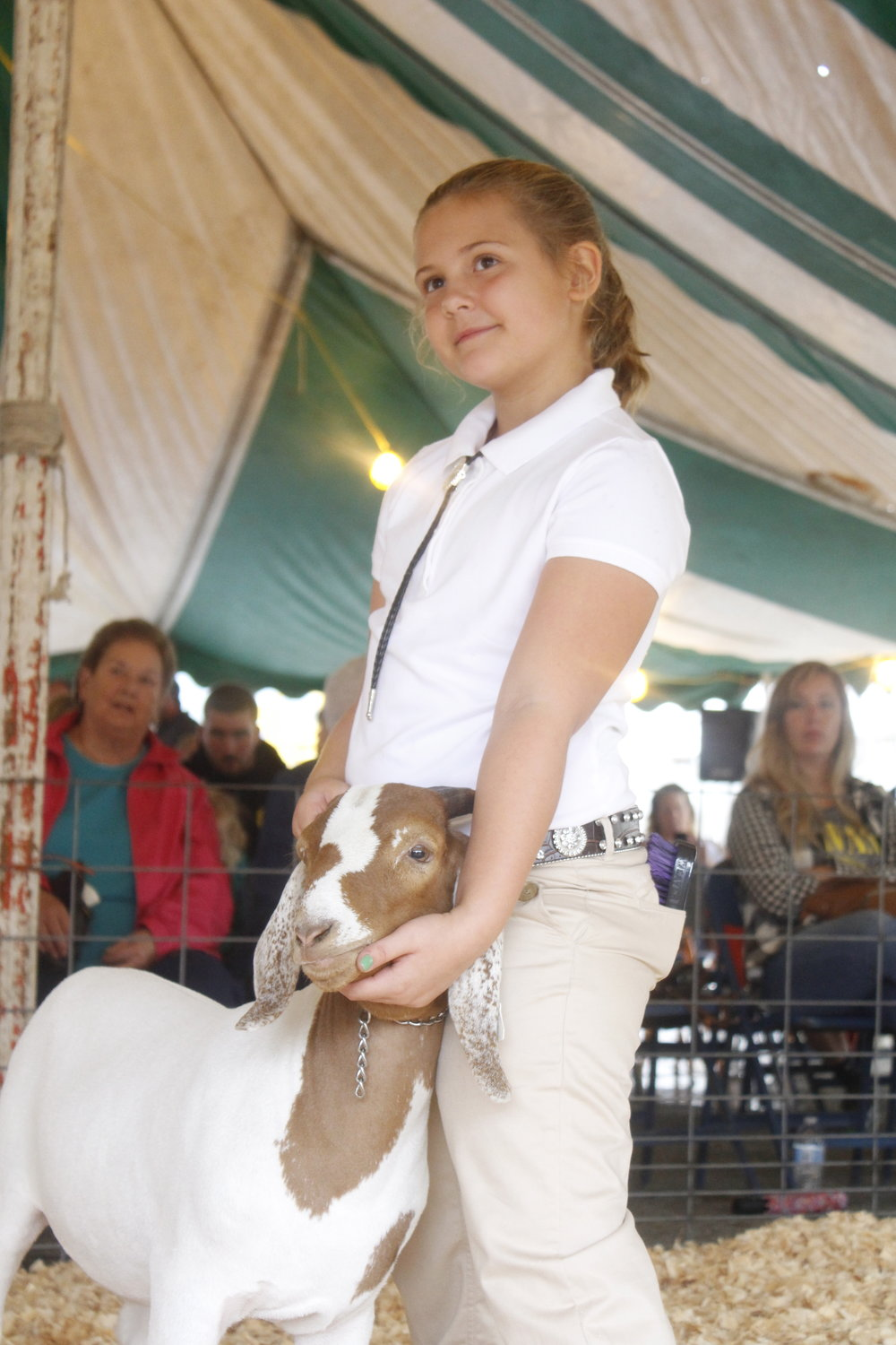 Madison Ohler always has a smile on her face while showing her livestock.