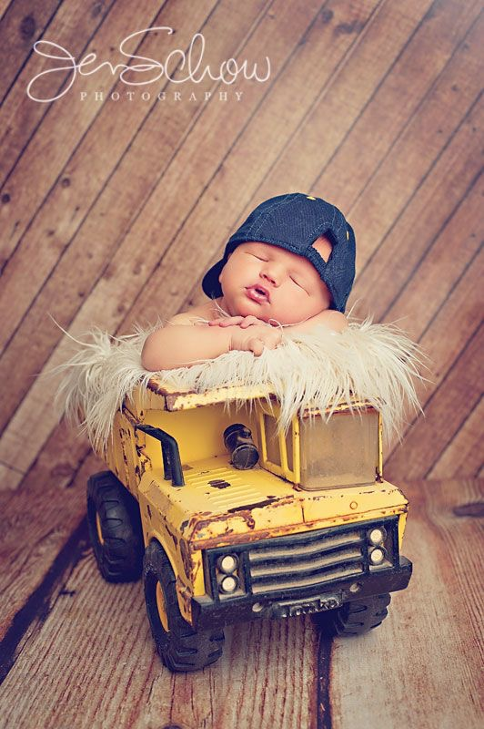 baby on yellow tractor.jpg