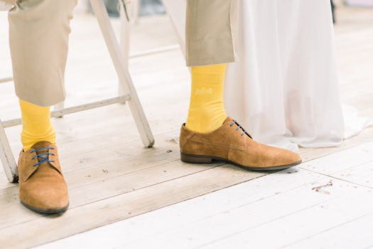 Modern groom wearing yellow socks