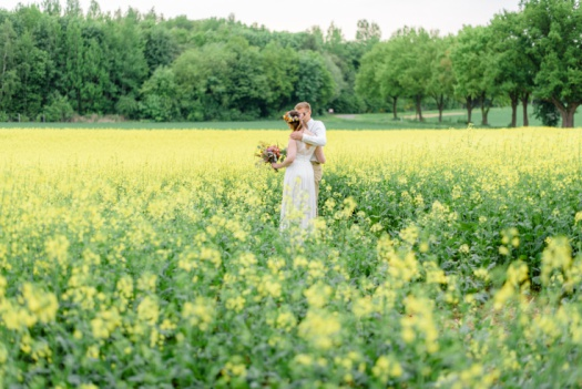 Wedding photos in a Canola field