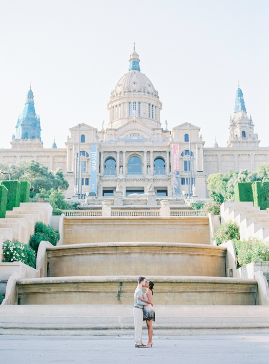 Couple kissing in front of Plaza Catalunya's fountain in Barcelona, Spain