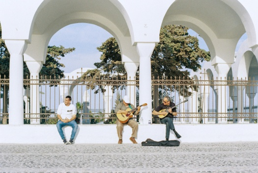Men playing guitar in Santorini, Greece