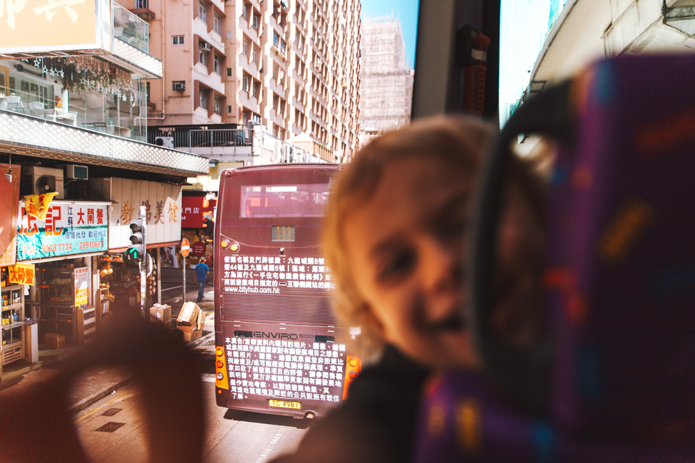 "Just a few minutes before this moment I took one of our favourite pictures on this bus. Such an intense portrait that fills me with awareness for what we're doing and the lifestyle we chose. Awareness of my children's eyes, of the daily colors, of the passion and unconventionality, of the strength we're gaining as individuals and as a family. I wanted to keep this for myself but then I was inspired to share it. The picture I'm talking about is the very first one you see in this article and it'll be the first one I'll show him when he'll ask: ""Mama, have we ever been to Hong Kong?"""
