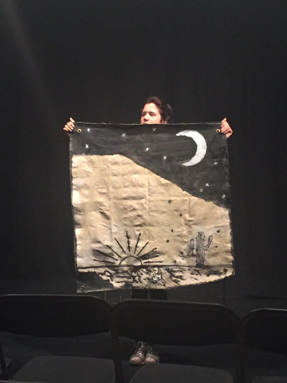Natasa holding up the desert landscape pre-show.