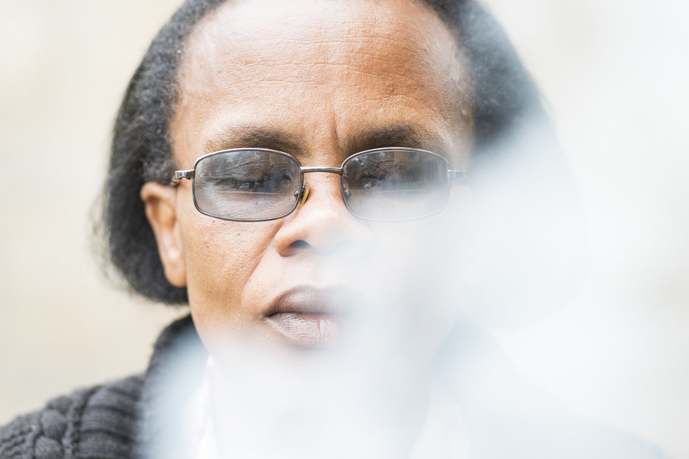Appolinarie, a mother of two and Rwandan refugee based in Nairobi, meditates in the smoke of burning paper - paper that had her traumas and unforgiveness listed. It's a key time of personal freedom found during the trauma healing course run by SIM in Nairobi.