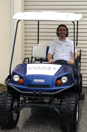 Dario Franchitti on a Coast Autonomous self-driving golf cart .
