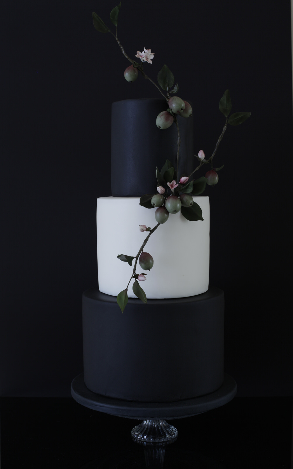 plumb and blossom wedding cake