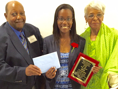 The late Beverly Johnson, at right, presenting an award to student Drew Valentine, with husband and AMBYESE co-founder Wendell Johnson.