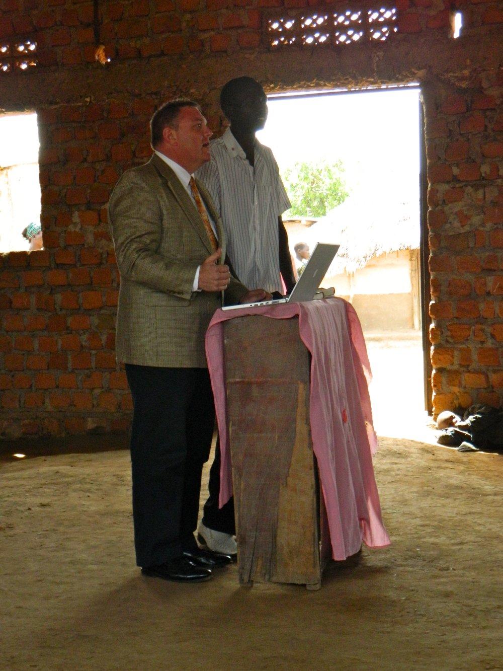 Jim preaching in Uganda