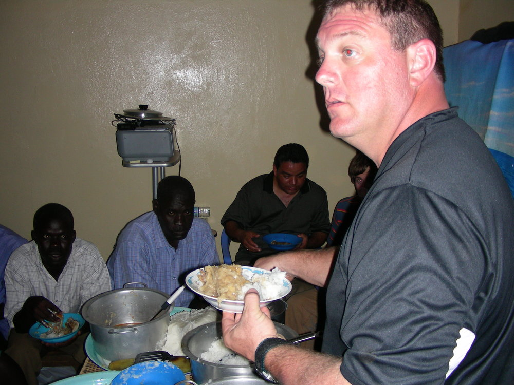 "In the photo below, Jim was serving pastors & their wives- Jim did the ""southern thing"" & fed the women first. This was not culturally acceptable, he did the ""Jim thing"" and insisted that while he was serving- the women would be honored & be served first- this was a GOOD DAY!  The Lord is honored by hungry ones eating at His Table!"