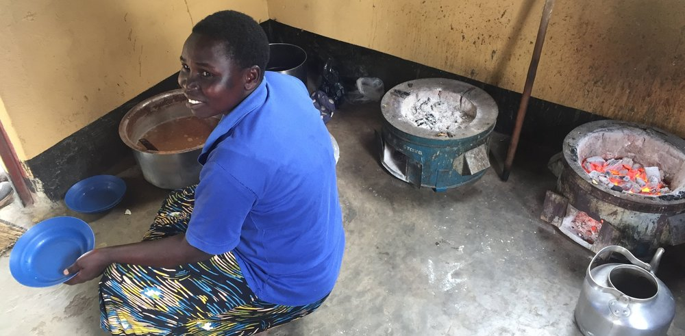 This is the KITCHEN in Northern Uganda- Every meal they cook on these charcoal stoves- precious! How long would most westerners make it cooking for 40-70 people 3 meals daily on these stoves? The faithfulness & strength of these amazing women who help Carla!