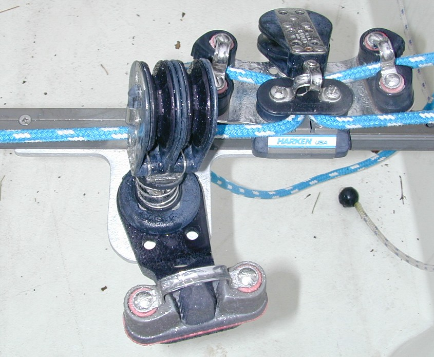 Top View  Mainsheet Bracket 2 = view from top. Bracket sized to provide clearance between track and swivel for car and control line to pass. Traveler car is high-load Harken with cleats mounted on car. Some people use a windward sheeting car.